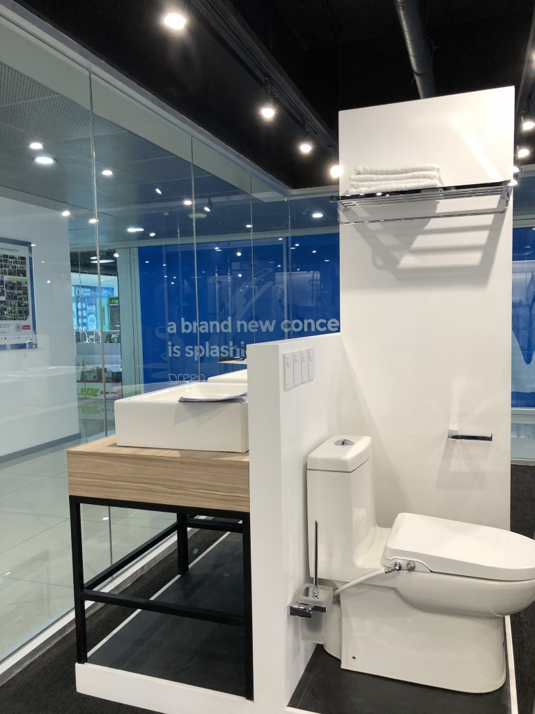 Our showroom features complete bathroom sets for a variety of spaces. It also includes the manual bidet seat and cover attached to Eton water closet.
